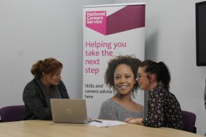 National Careers Service adviser gives careers advice to a client