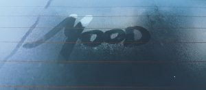 """Mood"" written onto a condensated car window"