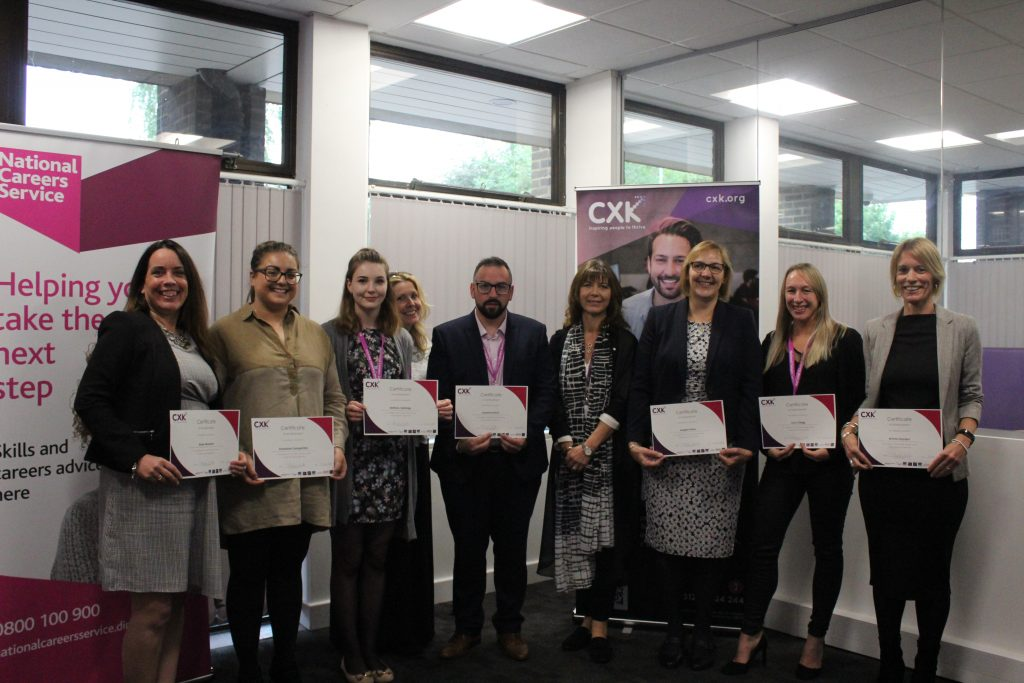 group of advisers holding their certificates