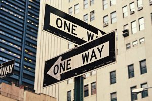 Street signs showing 'one way' in different directions