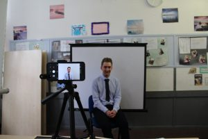 Young man films his video CV for Working Heads