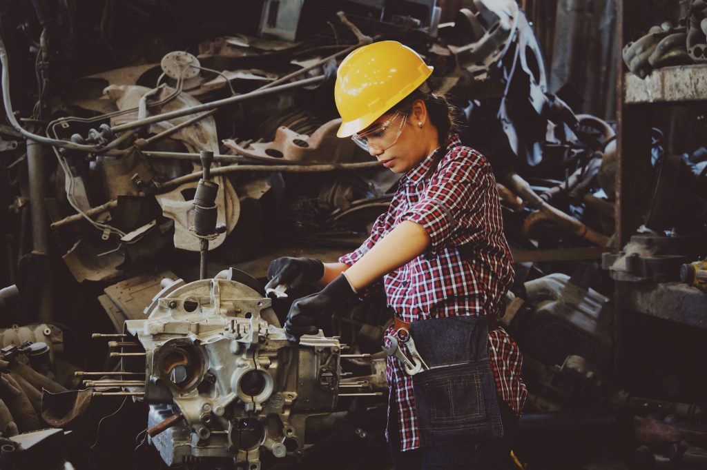 young female at work as an apprentice engineer